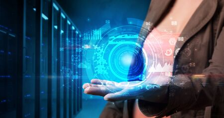 Woman holding hologram projection displaying biometric security concept Stok Fotoğraf