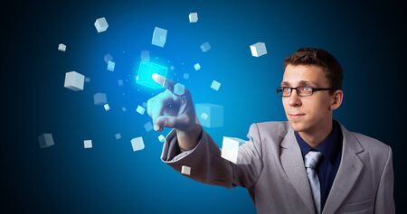 Man touching hologram screen displaying cube symbols