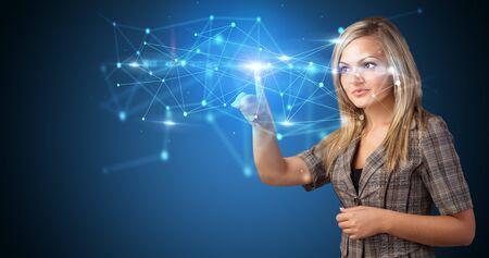Woman touching hologram screen displaying modern web system Stok Fotoğraf