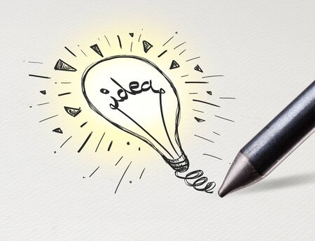Pencil drawing new idea bulb on white paper Banco de Imagens