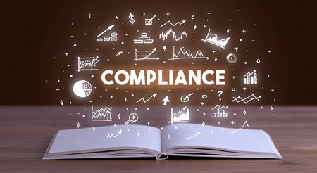 COMPLIANCE inscription coming out from an open book, business concept Stock Photo