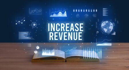 INCREASE REVENUE inscription coming out from an open book, creative business concept