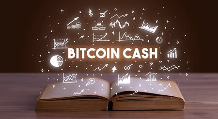 BITCOIN CASH inscription coming out from an open book, business concept Stockfoto