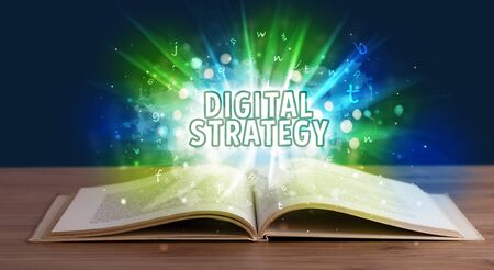 DIGITAL STRATEGY inscription coming out from an open book, educational concept