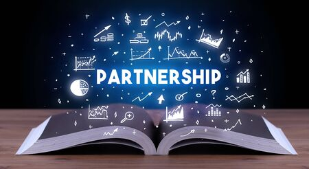 PARTNERSHIP inscription coming out from an open book, business concept