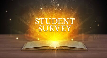 STUDENT SURVEY inscription coming out from an open book, educational concept Stock Photo