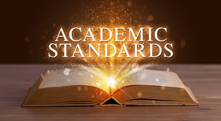 ACADEMIC STANDARDS inscription coming out from an open book, educational concept