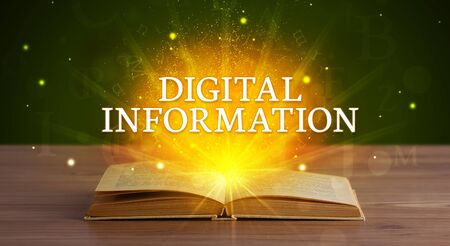 DIGITAL INFORMATION inscription coming out from an open book, educational concept Stock Photo
