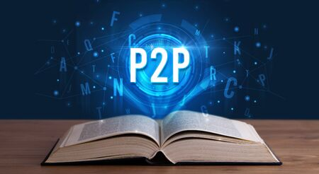 P2P inscription coming out from an open book, digital technology concept Stock Photo
