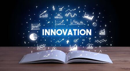 INNOVATION inscription coming out from an open book, business concept