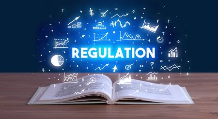 REGULATION inscription coming out from an open book, business concept