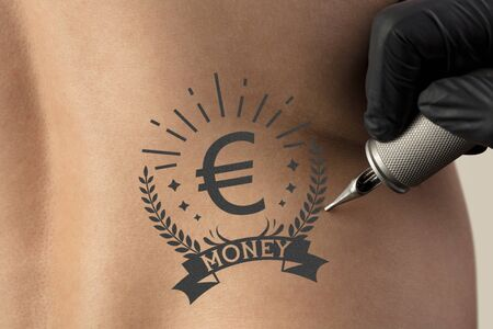 Hand tattooing money and currency concept on naked clear skin