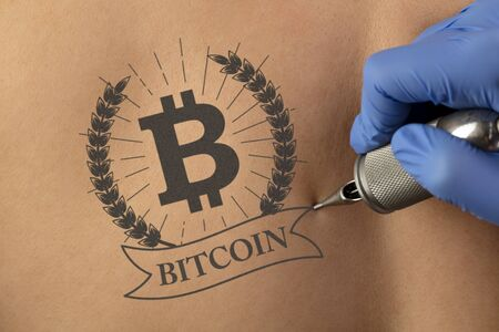 Hand tattooing cryptocurrency concept on naked clear skin