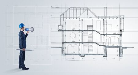 Architect watching a 2 dimension house plan
