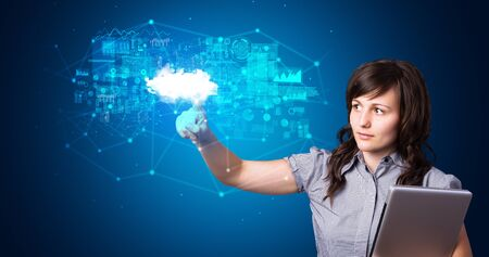 Woman touching hologram projection displaying information from cloud based system Banque d'images - 130071040