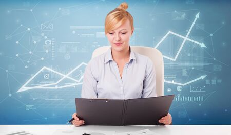 Business person sitting at desk with financial change, and report making concept 版權商用圖片