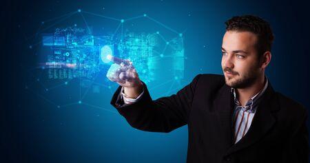 Man accessing modern hologram personal database with fingerprint identification Banque d'images - 130069964