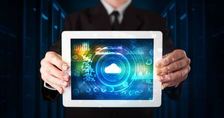 Hand holding tablet with cloud technology and dark concept Banque d'images - 130069852
