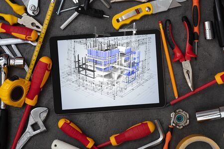 Tablet with construction tools and 3d house plan concept Zdjęcie Seryjne