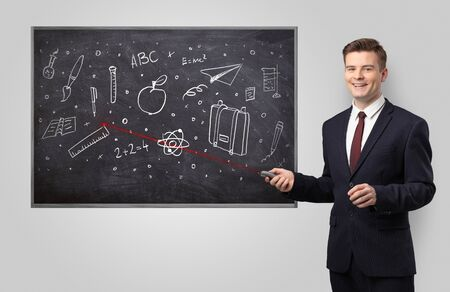 Handsome young teacher with laser pointer teaching 版權商用圖片