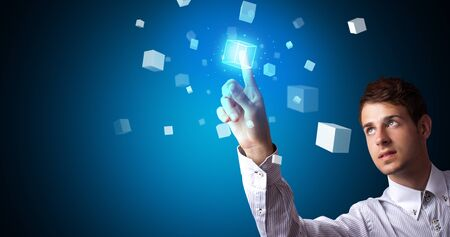 Man touching hologram screen displaying cube symbols Banque d'images - 130068238