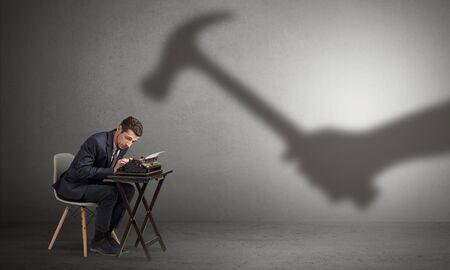 Shadow threatening hard worker man who is afraid 스톡 콘텐츠
