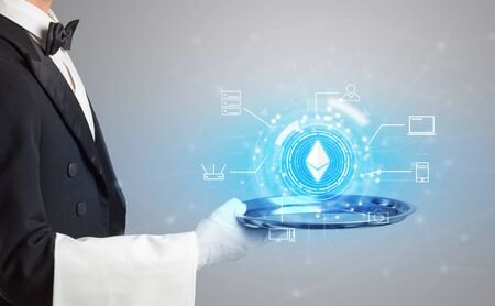 Waiter serving on a tray cryptocurrency and mining concept Stockfoto
