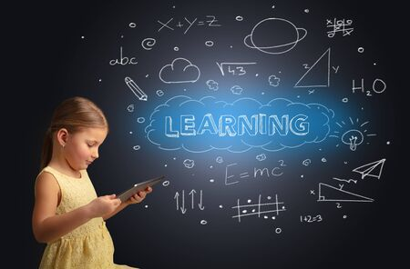 Adorable girl using tablet with educational concept