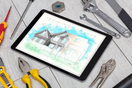 Tablet with construction tools and house plan concept Banco de Imagens - 132042944