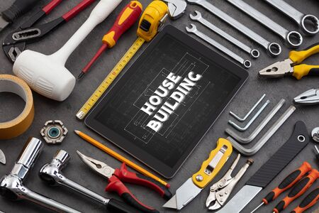 Tablet and tools with home under construction concept