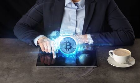 Business woman working on tablet with cryptocurrency and network concept 写真素材
