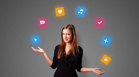 Young person juggle with application icons Stock Photo