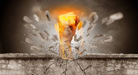 Big hand hits intense and breaks a crass stonewall Banco de Imagens