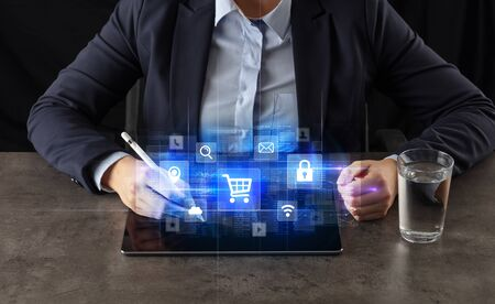Business woman working on tablet with online ERP system concept and dark background