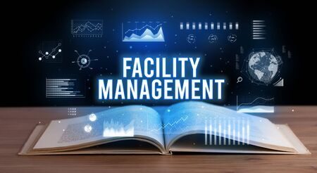 FACILITY MANAGEMENT inscription coming out from an open book, creative business concept Reklamní fotografie