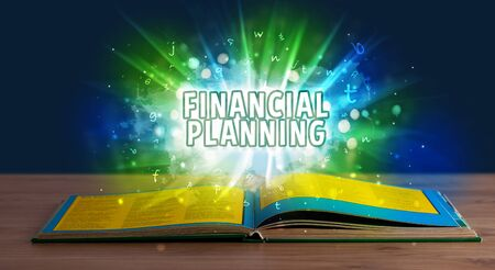 FINANCIAL PLANNING inscription coming out from an open book, educational concept Stok Fotoğraf