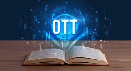 OTT inscription coming out from an open book, digital technology concept Reklamní fotografie
