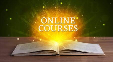 ONLINE COURSES inscription coming out from an open book, educational concept Stok Fotoğraf
