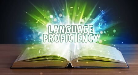 LANGUAGE PROFICIENCY inscription coming out from an open book, educational concept Stok Fotoğraf