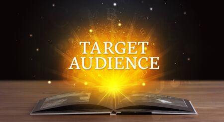 TARGET AUDIENCE inscription coming out from an open book, educational concept Stok Fotoğraf