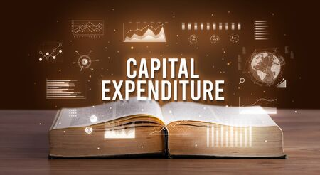 CAPITAL EXPENDITURE inscription coming out from an open book, creative business concept