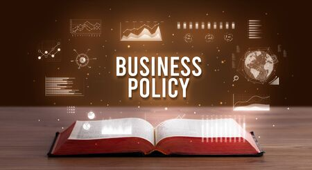 BUSINESS POLICY inscription coming out from an open book, creative business concept Reklamní fotografie