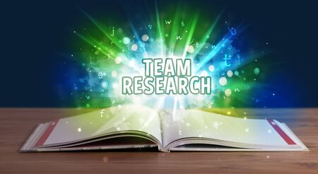 TEAM RESEARCH inscription coming out from an open book, educational concept Stok Fotoğraf