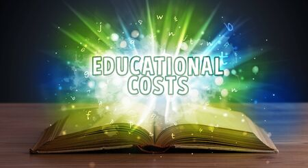 EDUCATIONAL COSTS inscription coming out from an open book, educational concept Stok Fotoğraf