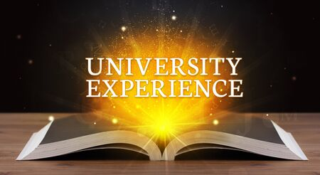 UNIVERSITY EXPERIENCE inscription coming out from an open book, educational concept Stok Fotoğraf