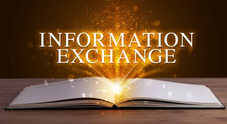 INFORMATION EXCHANGE inscription coming out from an open book, educational concept Stok Fotoğraf