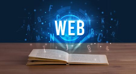 WEB inscription coming out from an open book, digital technology concept