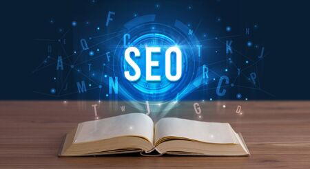 SEO inscription coming out from an open book, digital technology concept