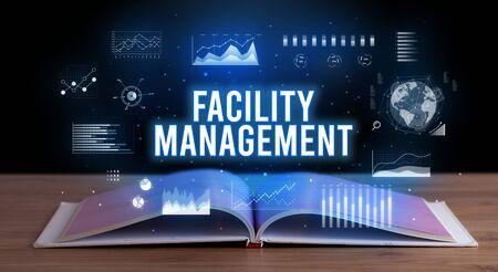 FACILITY MANAGEMENT inscription coming out from an open book, creative business concept Фото со стока