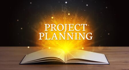 PROJECT PLANNING inscription coming out from an open book, educational concept